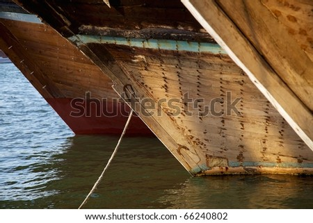 The bows of traditional wooden trading dhows moored in Dubai Creek, UAE. - stock photo