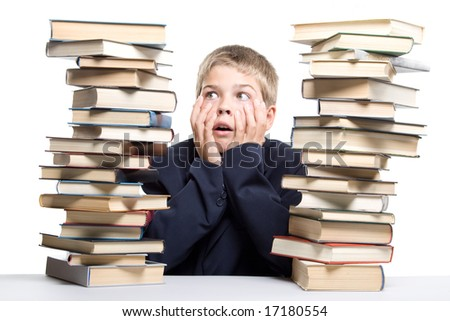 "The boy and a pile of books on a white background. Concept for ""Back to school"""