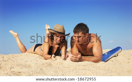 The boy and girl on sand