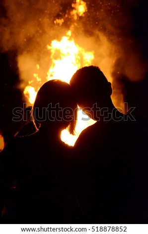 The boy and girl on the background of fire (love, relationships, feelings, romance - concept)