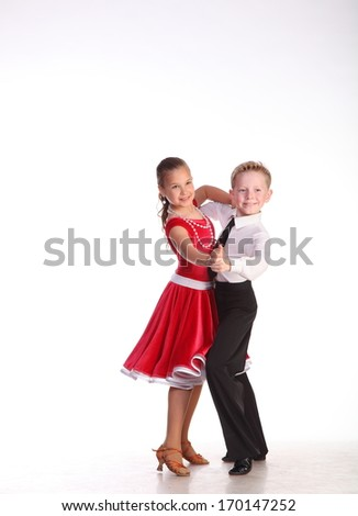 The boy and the girl in beautiful bright scenic suits for dances in dancing movement - stock photo