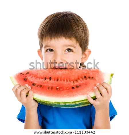 the boy bites a water-melon