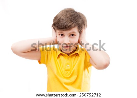 the boy closes the ears - stock photo