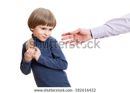 the boy didn't want to share the cake - stock photo