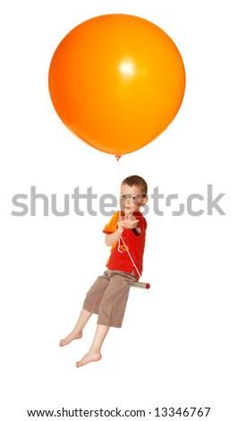The boy flies on balloons - stock photo