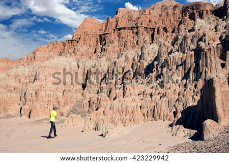 The boy goes to the interesting rocks. Cathedral Gorge State Park, Nevada, USA - stock photo