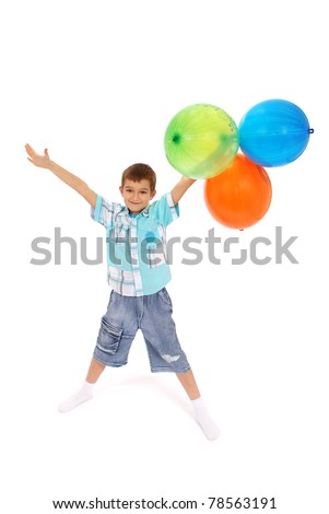 The boy holds four balloons