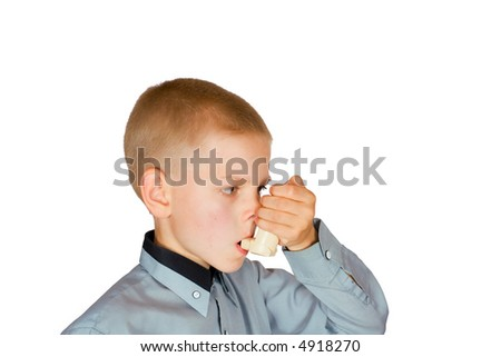 The boy injects an inhaler on an isolated background - stock photo
