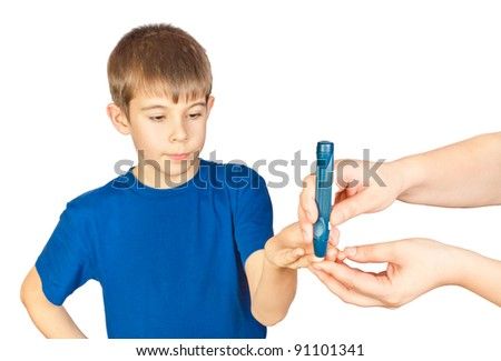 The boy is doing a test for diabetes. Photo isolated on white background - stock photo