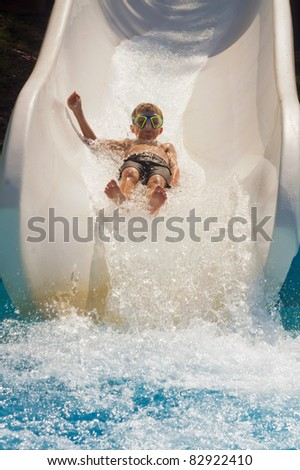 The boy is rolling with a water slide at a water park in Little Rock - stock photo