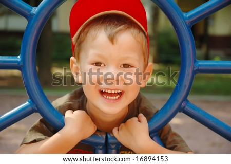 The boy laughs - stock photo