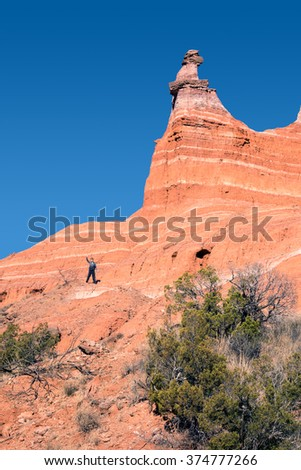 The boy on the hillside Capitol Peak in Palo Duro Canyon State Park, Texas, USA - stock photo