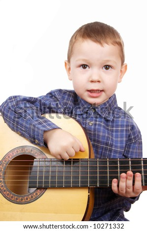 The boy plays a guitar - stock photo