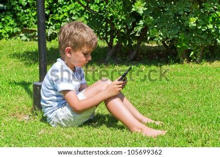 The boy reads the e-book - stock photo