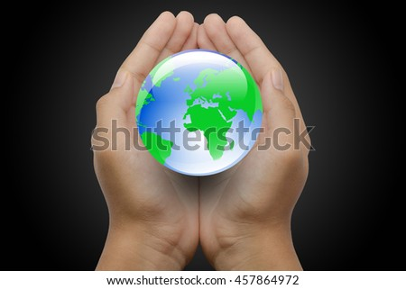 The boy's hands protecting green world.
