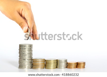 The boy's hands were a handful of coins arranged in accordance with the kind of coin.