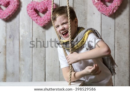 The boy screams in pain - stock photo