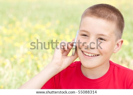 The boy speaks by phone - stock photo