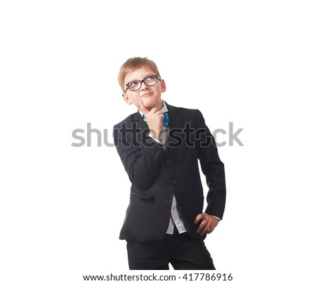 the boy student in a suit and tie with glasses standing isolated on white background and thinks - stock photo