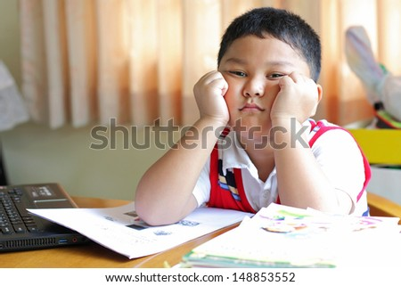 The boy tired of homework. - stock photo