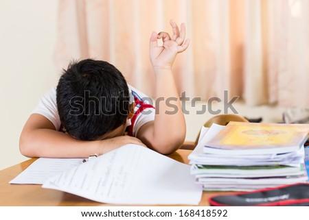 The boy tired of homework. - stock photo