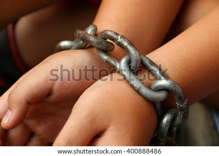 The boy was chained to the arm. - stock photo