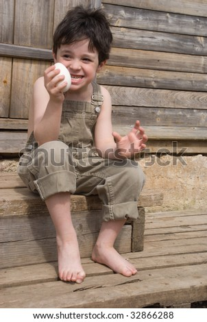 The boy with big goose egg on porch of house - stock photo