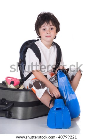 The boy with  gray suitcase and flippers - stock photo