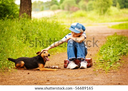 The boy with his dog in the forest - stock photo