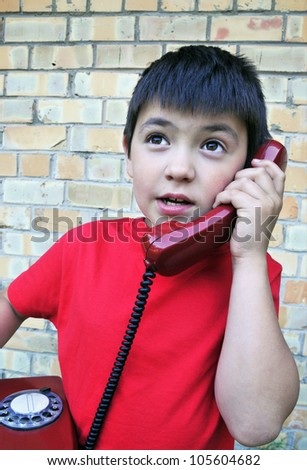 The boy with old telephone - stock photo