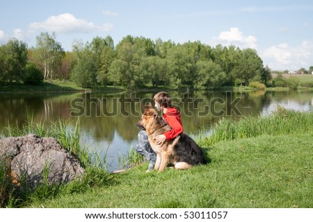 The boy with the dog near the river - stock photo
