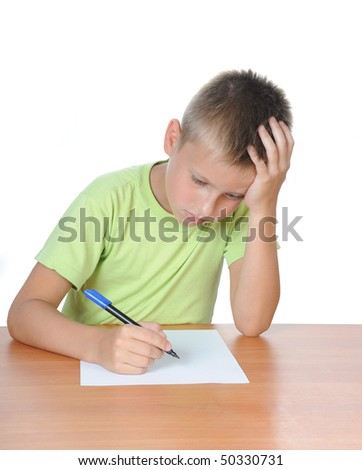 The boy with the textbook behind a table over white