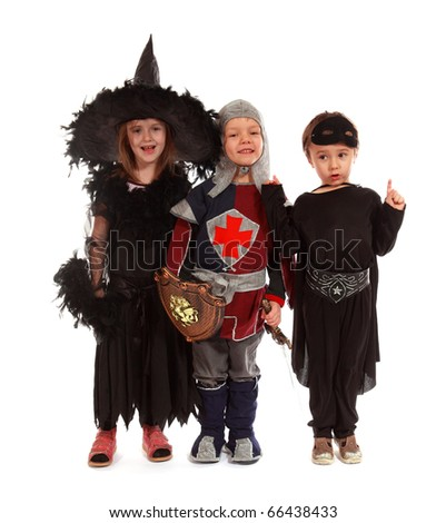 The boys and girl wearing witch halloween costume on white