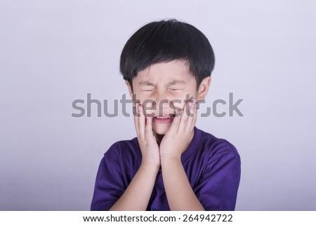 The boys having a toothache - stock photo
