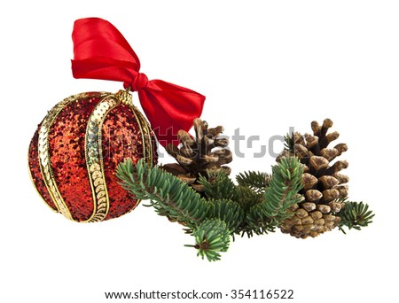 the branch of fir-tree and red ball is isolated on a white background - stock photo