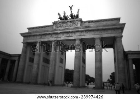 The Brandenburg Gate (German: Brandenburger Tor) is a former city gate and one of the main symbols of Berlin and Germany.  - stock photo