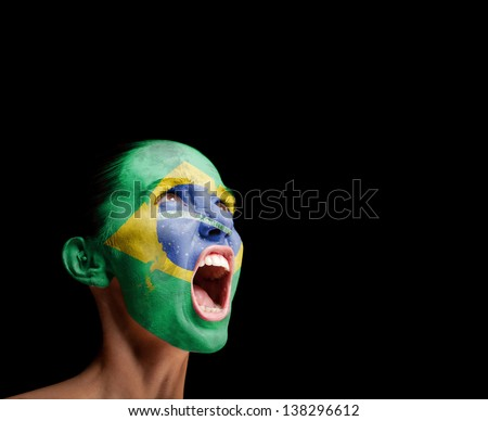 The Brazilian flag on the face of a screaming woman. concept - stock photo