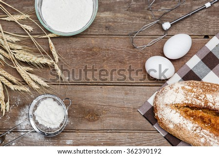 The bread on an wooden background - stock photo