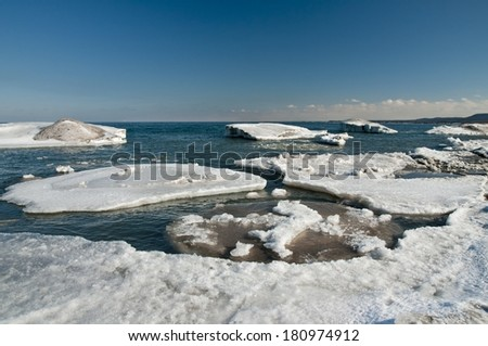 The break up of shore ice on Lake Ontario - stock photo