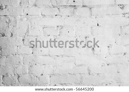 The brick walls are covered with white paint - stock photo
