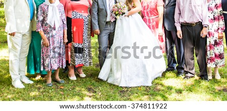 The bride and groom, and guests - stock photo