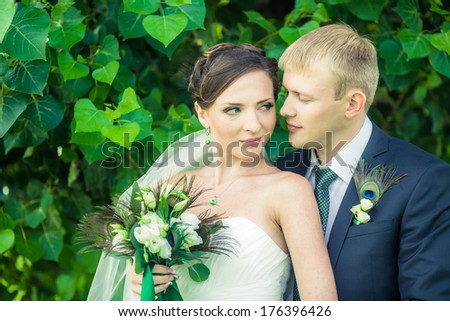 The bride and groom are walking in the park. - stock photo