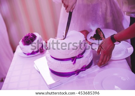The Bride and groom cut the wedding cake.