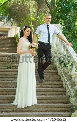 the bride and groom just married in a registry office wedding day went for a walk in the park for a photo session