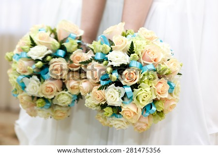 The bride at a wedding holding a bouquet of flowers. - stock photo