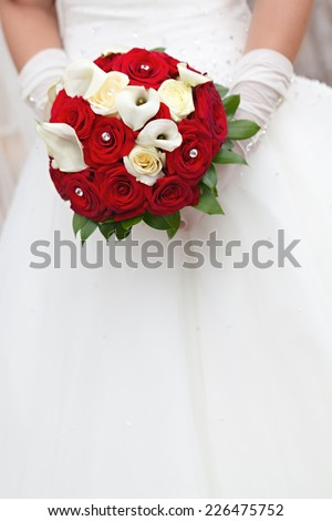 The bride at the wedding is holding a bouquet of flowers  - stock photo