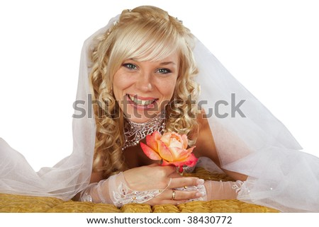 The bride has a rest in an armchair on a lawn.