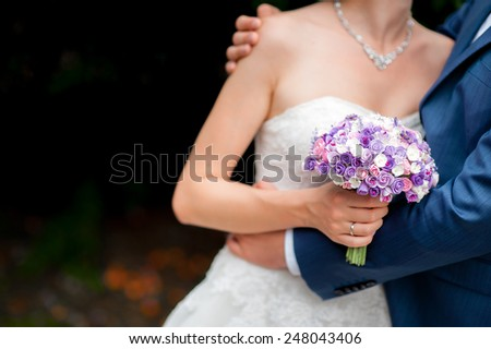 The bride holds a wedding bouquet purple - stock photo