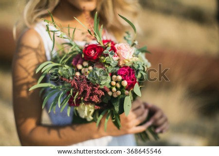 The bride in a white dress with beautiful bouquet