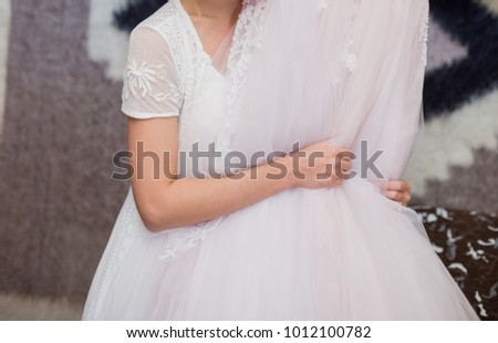 the bride is holding her wedding dress